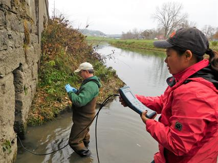Kelly and Li Taking a Water Quality Sample of a Spring Outlet in Galena, Illinois